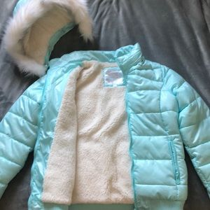 Light blue and white puffer coat from Justice.